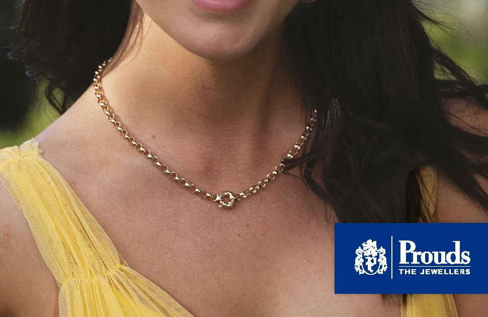 Gold necklace around woman's neck
