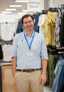 Man in front of clothes